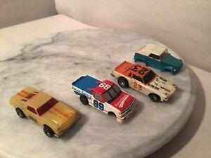 4- VINTAGE HO SCALE SLOT CARS.