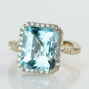 Ladies´ ring (14k gold) with an aquamarine and diamonds