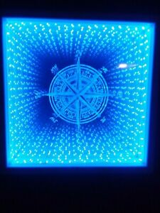 Infinity Mirror with color changing LEDs and 44 key wireless remote.