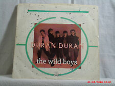 DURAN DURAN- a-(45 W/PIC. SLEEVE) -THE WILD BOYS / CRACKS IN THE PAVEMENT - 1984