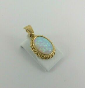 9ct Gold Opal Pendant Oval 19mm Hallmarked with Gift Box