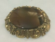 with brown striated centre 1¾ ins long Lovely gold tone metal oval shaped brooch
