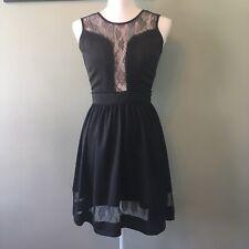 En Creme lace cutout A-line black dress