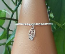 silver plated stretchy stacking bracelet with hamsa charm