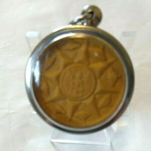 Amulet from Thailand blessed by a Monk in Temple with a wearable plastic case