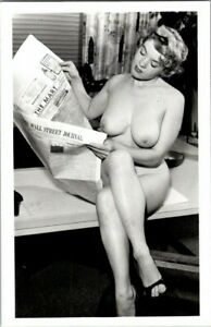 RPPC 1950'S. BUSTY NUDE GAL, READING WALL STREET JOURNAL, RISQUE. PL19
