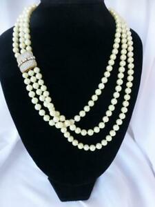 Beautiful CINER Three-Strand Faux Pearl Necklace with Intricate Rhinestone Clasp