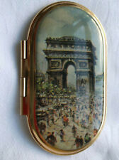 Small slim hinged oblong handbag mirror with Arch de Triomphe scene on front.
