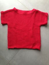 Pull sans manche rouge. Taille 10 ans