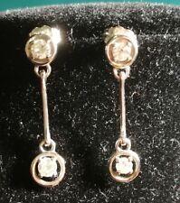 Pendientes colgantes de oro blanco y 4 maravillosos diamantes