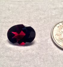 13.46 carat natural garnet with a good oval cut and unique crystal inclusions