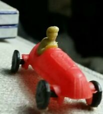 Vintage plastic MINI TOY RACE CAR WITH DRIVER, WHEELS MOVE