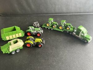 Siku Job Lot Of 4 Small Tractors, Low Loader Lorry, And Some Trailers.