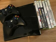 Microsoft Xbox 360-black with a couple of games