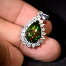 5.16ct Natural Play-Of-Color Welo Black Opal Pendant With Topaz in 925 Silver