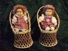 """boy and girl 5-1/2"""" dolls in wicker chairs porcelain heads cloth bodies"""