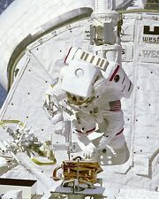 Bruce McCandless uses screw gun during EVA in Challenger payload bay Photo Print