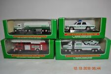 FOUR Miniature Hess Trucks in Original Boxes  Patrol Car,Fire Truck, Race Transp
