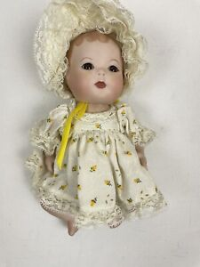 vintage porcelain baby girl Yellow Floral Ruffle Dress doll 1982