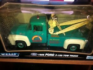 Welly  Rainbow Towing 1956 Ford F-100 Wrecker Tow Truck 1/18