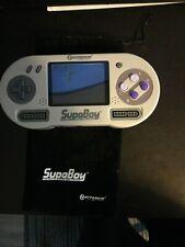 Hyperkin SupaBoy Launch Edition White Handheld Super Nintendo with controller.