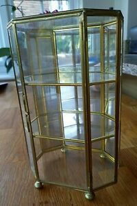 Small metal & glass display cabinet hinged door mirror back.