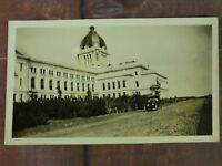 Model T Ford in Front of Large Building RPPC Real Photo Postcard Unposted