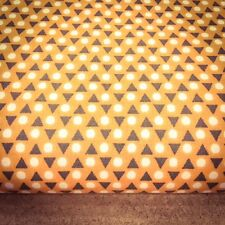 Triangle and spots on orange 100% Cotton Fabric. Price per 1/2 meter