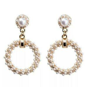 Medium gold round hoop earrings with pearls