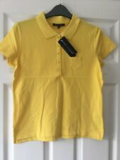 NEW YELLOW POLO TOP SIZE M  UNDERARM to UNDERARM. 18 Inches