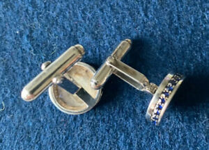mens White Gold (not the base) and sapphire cuff links.classy simple elegance!!