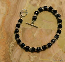 BANDED AGATE BRACELET WITH SWAROVSKI RONDELLS AND A STERLING SILVER CLASP 8 IN.