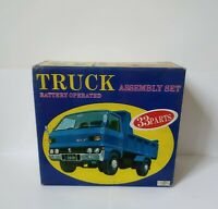 DAIYA Japan 1:20 ISUZU ELF TRUCK Battery Operated Toy Car Kit MIB 1975 Nuovo