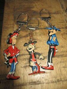 Lucky Luke-Lot portes clé publicitaire-Lessive OMO-3 personnages-Années 60-