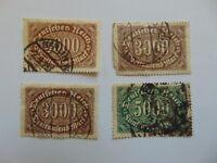 4 gestempelte Marken Dt. Reich 3x 3000 Mark Mi 254 a|b, 1x 5000 Mark Mi 256 a|b