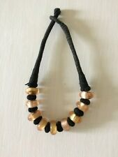 LARGE NECKLACE -GOLD GLASS BEADS BOUND IN THICK BLACK COTTON HAND MADE IN FRANCE