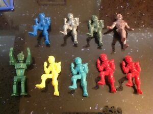 Lot of 9 vintage colorful1950's Archer Ajax hard plastic Spacemen, used