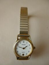 Ancienne petite montre femme mécanique dorée   PULSAR   bracelet extensible