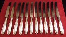 Service de 12 couteaux de table en métal argenté WMF Nirosta