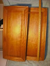 Pair of curved cherry doors from a bathroom vanity cabinet