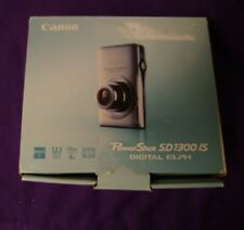 Canon PowerShot Digital ELPH SD1300 IS 12.1 MP Digital Camera - Silver, complete