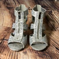 Silver Slipper Mikel Size 7.5 with glitter accents and a mirror finish heel