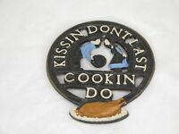 """Vintage Cast Iron Trivet """"Kissin Don't Last Cookin Do"""" Original Paint"""