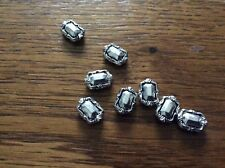 Silver tone flat oblong spacer beads approx 8mm x 60.     Lb