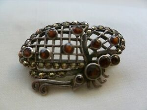 VINTAGE STERLING SILVER BROOCH SET WITH RED GLASS STONES AND MARCASITE