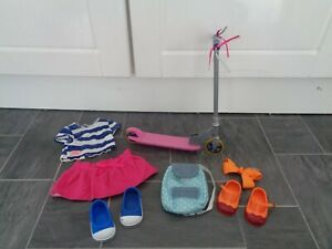 our generation bundle-scooter,outfit+shoes,rucksack,extra shoes+hair slide
