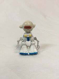 """vintage  diecast 2 3/4""""  robot Figure Metal Body & Wheels Plastic Head And Arms"""
