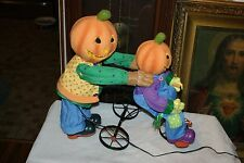 Pumpkin Dad & Little Boy Riding Tricycle Electric Light Up Halloween Decoration