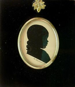 SILHOUETTE OF A YOUNG BOY BY B.ROMERO 1927