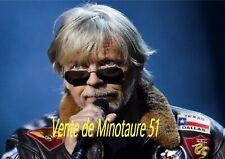 Renaud  regard au dessus des lunettes - plastifiée